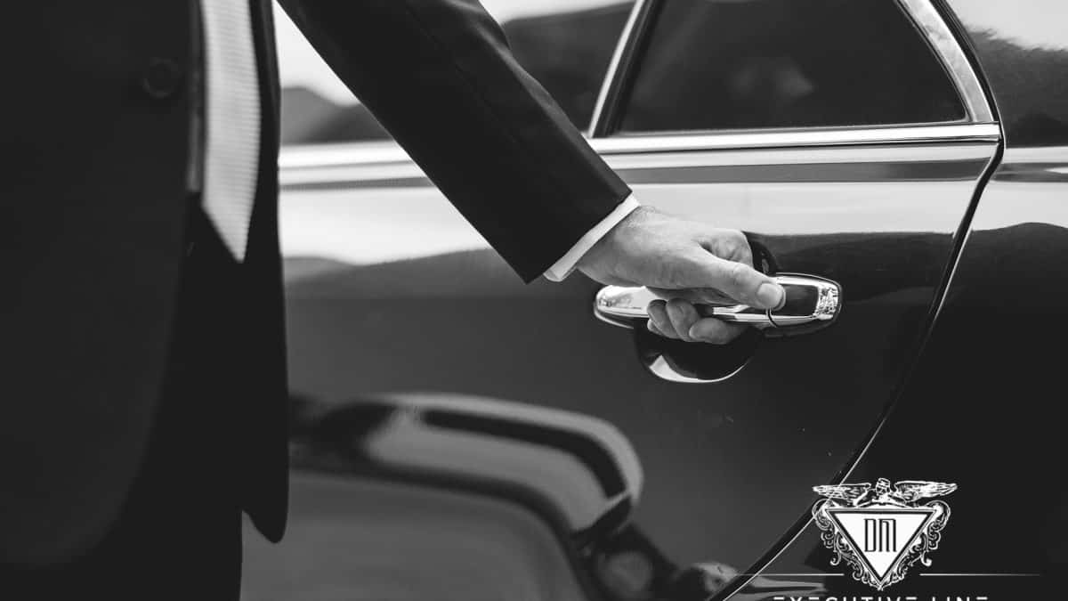 smart dressed chauffeur opening limo door taxi alternative in dublin
